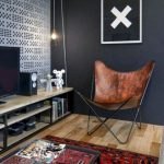 Leather Butterfly Chair, Wooden Floor, Wooden Cabinet, Red Rug, Coffee Table, Black Wall