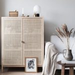 Light Wooden Cabinet With Rattan Door, Light Wooden Floor, White Rug, White Sofa, Wooden Round Coffee Table