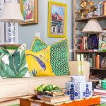 Living Room, Beige Sofa, Colorful Pillows, Neon Green Coffee Table, Rattan Basket, Grey Wall, Bookshelves, Wall Decorations