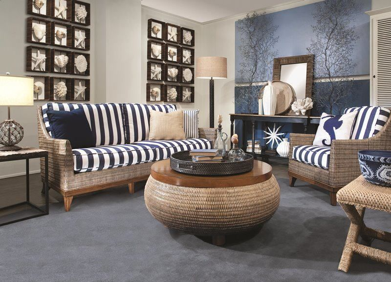 living room, blue floor, rattan sofa, rattan round cofee table, rattan chair, rattan side table, blue accent wall, off white wall, shell decor