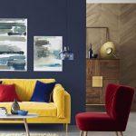 Living Room, Dark Grey Wall, Light Grey Floor, Yellow Velvet Sofa, Red Velvet Chair, Rug, White Round Coffee Table