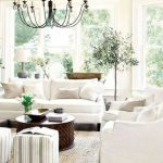 Living Room, Dark Wooden Floor, White Sofa, White Wall, White Ceiling, Black Metal Chandelier, White Ottoman, Wooden Coffee Table
