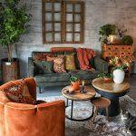 Living Room, Grey Floor, Rug, Grey Sofa, Grey Textured Wall, Orange Chair, Orange Pillows, Wooden Cabinet, Plants On Pot