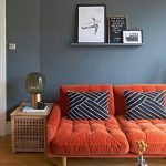 Living Room, Grey Wall, Wooden Floor, Woodne Side Table, Orange Sofa Tufted, Gey Rug, Black Coffee Table, Floating Shelf