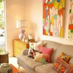 Living Room, White Floor, Beige Wall, Beige Sofa, Colorful Pillows, Orange Table, Wooden Side Table, Colorful Paintings