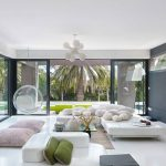 Living Room, White Floor Tiles, White Ceiling, Glass Wall Acrylic Swing Chair, White Flat Sofas Without Backs