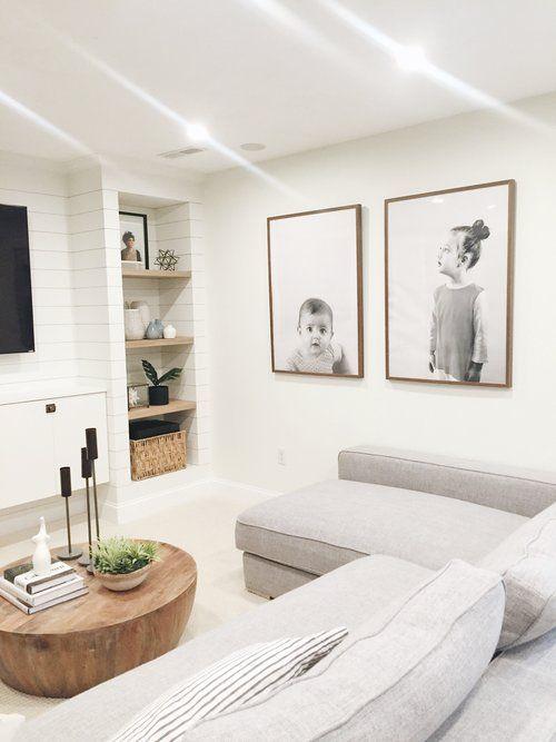 living room, white floor, white sofa, white wall, white accent wall, wooden built in shelves