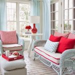 Living Room With White Subway Floor Tiles, White Rattan Chair And Sofa, White Ottoman, White Side Table, Red Table Lamp, Red Pillows, Red Accent Cushions, Red Tray
