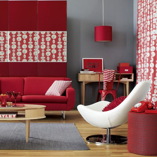 living room, wooden floor, grey rug, white chair, red sofa, red accent wall, red covered pendant, red chair, wooden study table, wooden coffee table, red curtain