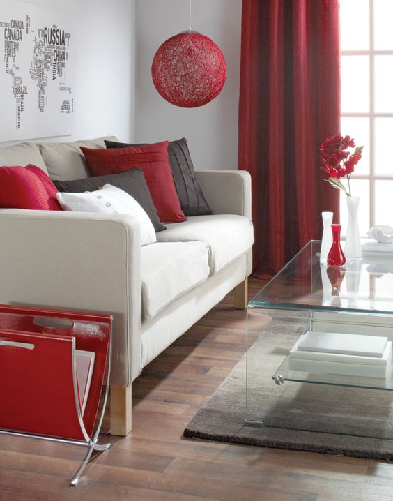 living room, wooden floor, rug, acrylic table, red magazine holder, white sofa, red pillows, red pendant, red curtain