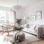 Living Room, Wooden Floor, White Sofa, Rattan Chair With White Cushion, Ottoman , Black Round Coffee Table, White Wall, White Ceiling, White Pendant, White Floor Lamp, White Curtain,