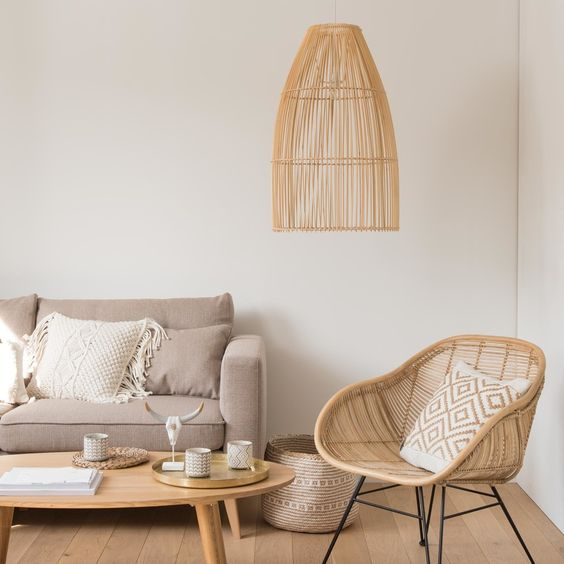 living room, wooden floor, white wall, beige sofa, rattan chair, round wooden coffee table, rattan pendant lamp