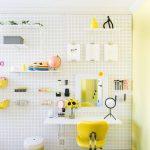 Make Up Stationwith White Pegboard Wall, Dark Wooden Floor, White Floating Table, Yellow Office Chair