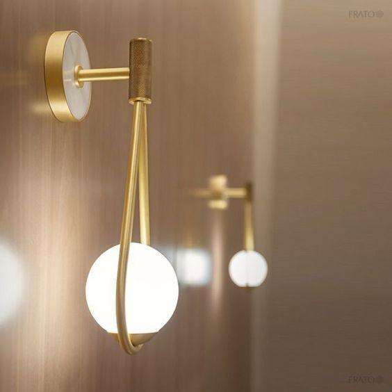 modern sconces with golden support, golden stalk, white buld