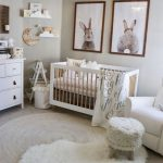 Nursery, Gey Floor, Round Rug, White Fur Rug, White Ottoman, White Chair, White Wooden Crib, White Wall, White Cabinet, Rabbit's Pictures