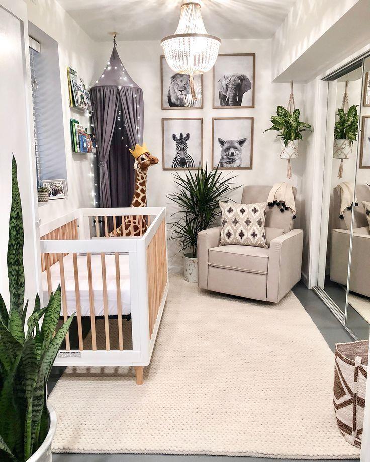 nursery, mirror door, grey floor, beige rug, beige chair, off white wall, animals' pictures, stuffedgiraffe, white wooden crib, grey tent