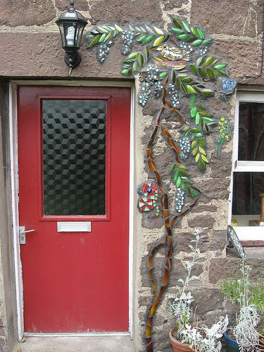open brick stone with mosaic tendrils of plants