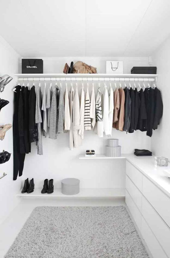 open closet in a small area with floating rack, floating shelves, floating table, white cabinet, shoe racks