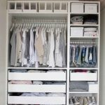 Open Closet With Drawer, Shelves, Rails All Built In In A White Open Cupboard