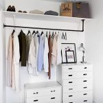 Open Closet With White Wall, White Drawers Cabinet, Black Metal Rail, White Shelves