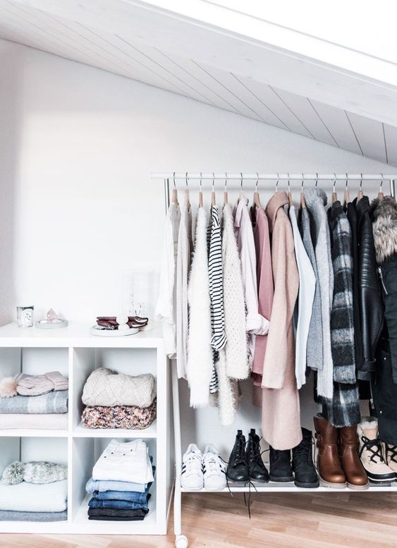 open clothes, white rails with shelves, white shelves on the sloping ceiling