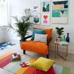 Orange Chair, Colorful Stripes Rug, Small Side Table, Plant, White Wall, Wall Decoration