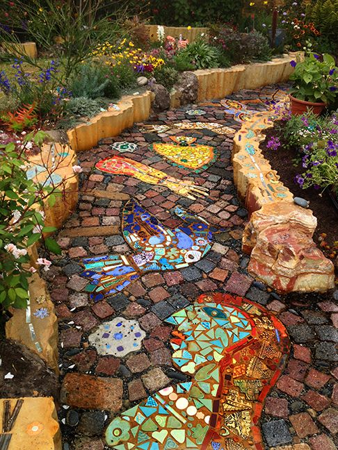 pathway, square earth tiles, colorful mosaic, brown stones on frame
