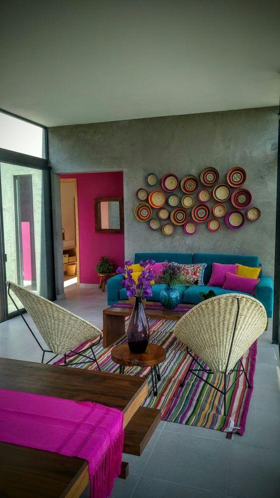 rattan shell shaped chairs, colorful stripes rug, green sofa, grey wall, grey floor