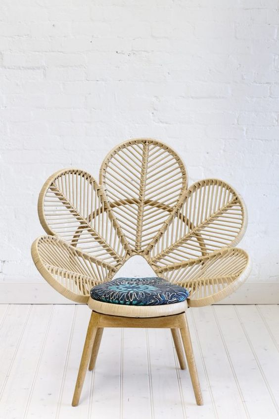 rattan woven chair with peacock shaped back, blue cushion, wooden legs