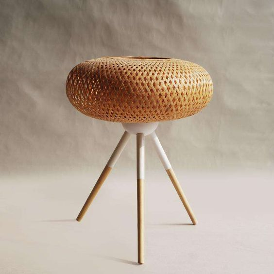 rattan woven seating on stool with three wooden legs