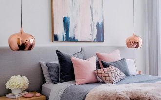 rose copper bedside hanging lamps, grey bedding, pillows, wooden bedside table, white wall