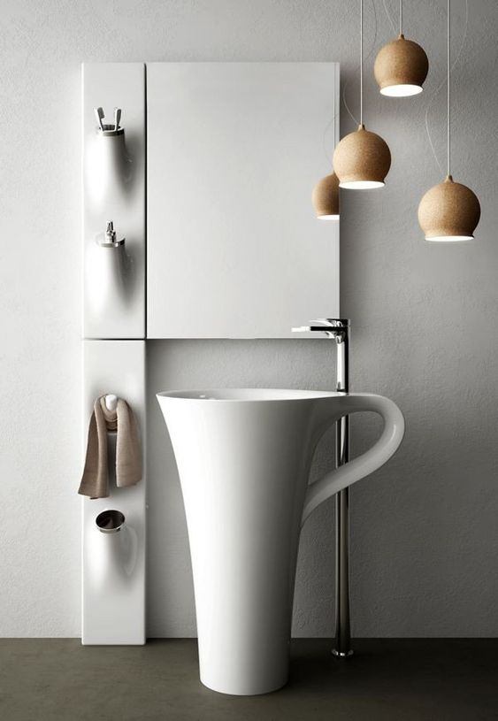 round white sink looks like a cup, smooth cabinet, metalic faucet from the floor, brown pendants