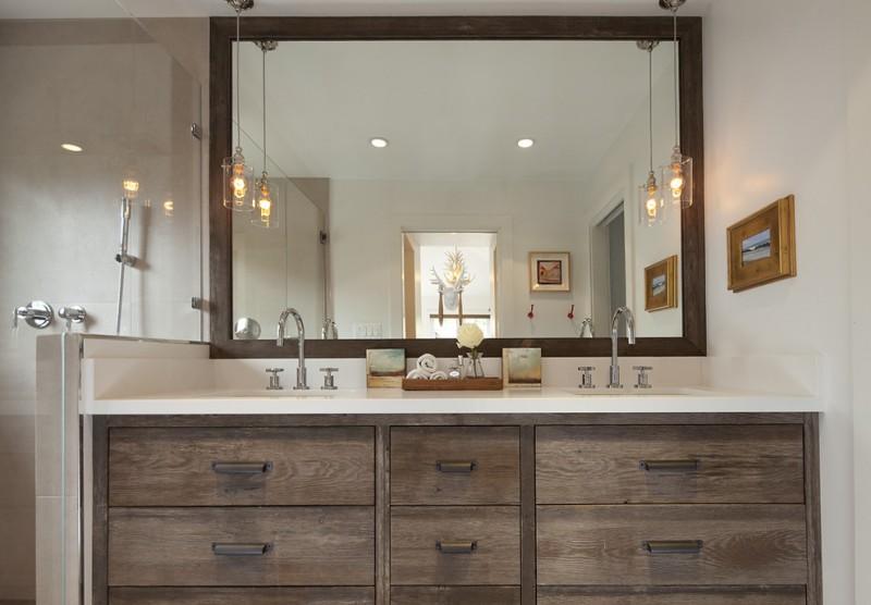 rustic bathroom vanities with tops shower fixtures wide wooden framed wall mirror glass pendant lamps sinks glass shower doors caesarstone countertop