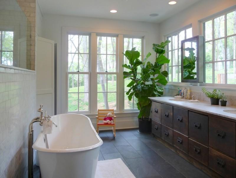 rustic bathroom vanities with tops wall mirror glass windows white subway tile acrylic freestanding tub wooden floor white bathroom rug chair granite countertop