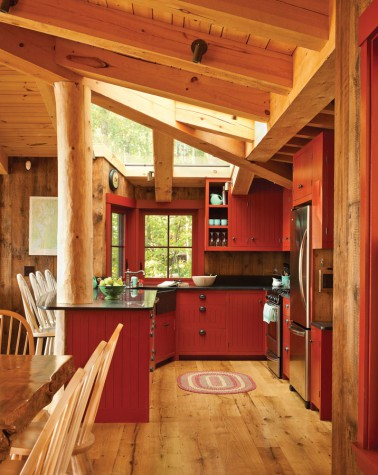 rustic kitchen, wooden floor, red cabinets, red framed window, black counter top
