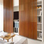 Sliding Wooden Slats On White Entertainment Shelves, White Floor, Grey Sofa, Small Coffee Tables