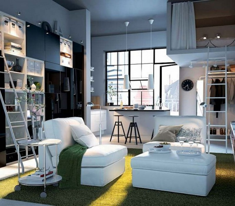 small apartment, green grass rug, white chairs ottoman, white side table, shelves and cupbor, small kitchen, small island, bedroom above