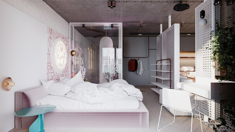 small apartment, wooden chevron floor, pink bed platform, white bedding, white wall, pegboard divider, shelves, kitchen and living room on the other side, study table