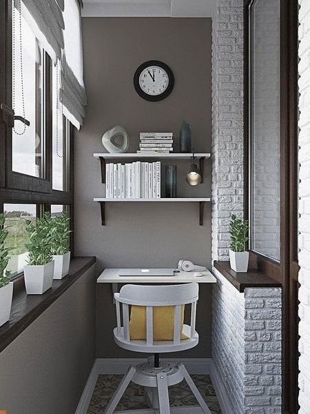 small balcony, patterned floor tiles, grey wall, glass wall, roamn shade, floating shelves, white open brick wall, white floating table, white wooden chair