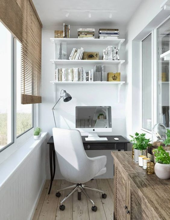 small balcony, wooden floor, white wall, white floating shelves, black table, white office chair, wooden cabinet, wooden japanese shade
