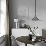 Small Dining Set With Dark Round Table, White Modern Midcentury Chairs, White Cabinet, Silver Pendant, White Wall
