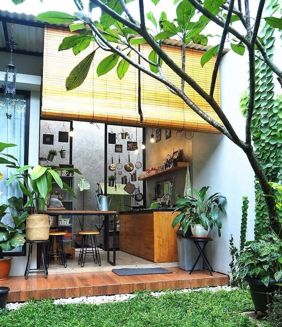 small garden with grass, plants, near the kitchen and dining room, wooden small porch