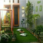 Small Indoor Garden With Grass, Plants On Pots And Vertical Wire, Swing Bench