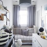 Small Nursery With Stripe Rug, White Drawers, Light Grey Shelves, Light Grey Cot, White Wall, Grey Curtain, Grey Pendant