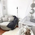 Small Nursery, Wooden Floor, Grey Round Lounge Chair, White Rug, White Cot, Mobile, White Wall, Floor Lamp