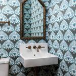 Small Powder Room, Blue Wallpaper, White Sink, White Toilet, Golden Framed Mirror, Sconce