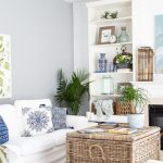 Square Rattan Box For Coffee Table, Rug, White Sofa, White Wall, White Shelves, Fireplace