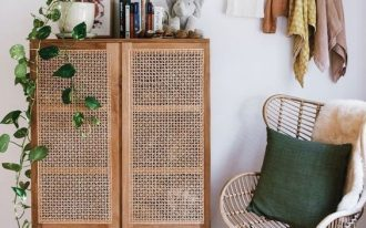 tall wooden cabinet with rattan door, wooden legs, wooden floor, rattan chair, rattan rug