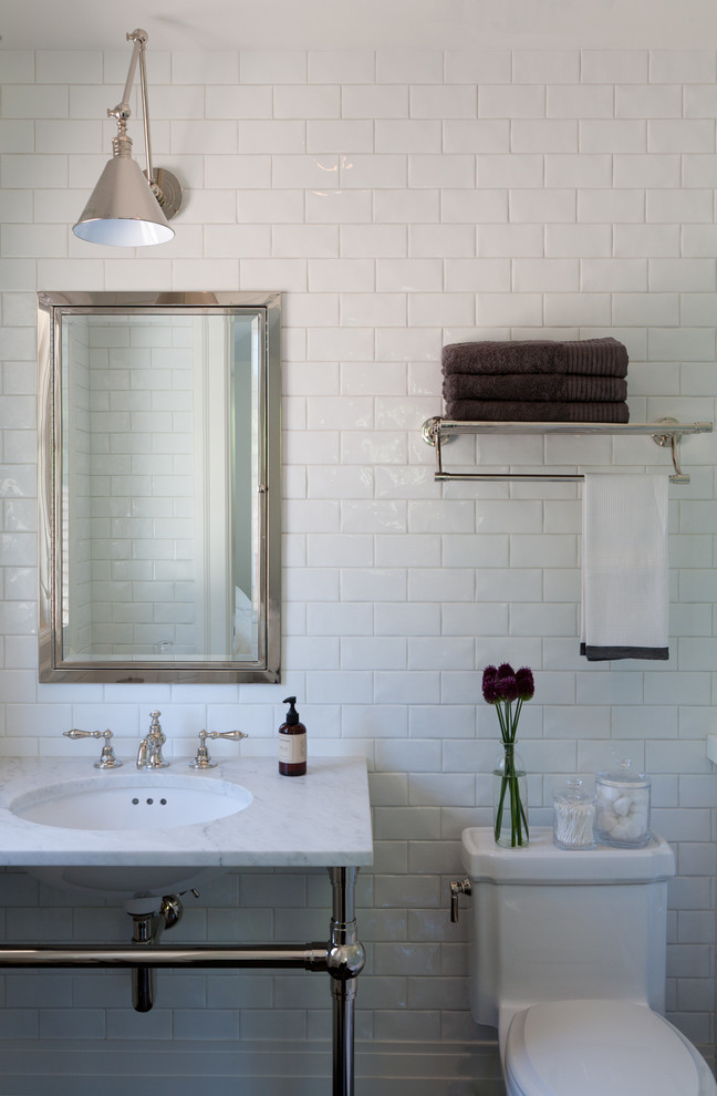 towel rack height white subway wall tiles white freestanding sink toilet chrome framed wall mirror industrial chrome wall sconce