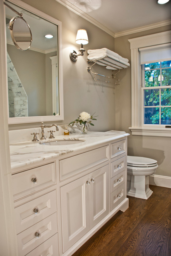 towel rack height white vanity wall mirror undermount sink faucet wooden floor glass window toilet grey walls wall sconces white shade
